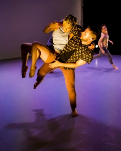 "Javier Baca lifts Natsuki Arai in ""Still and Still Moving."" Photo by Alex Escalante."