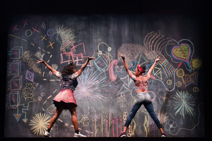 Beatrice Capote (L) and Fana Fraser get covered in chalk from Elizabeth C. Nelson's set designs. Photo by Christopher Duggan.