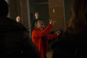 Arielle Rosales invites attendees to use their voices to create a group rhythm.